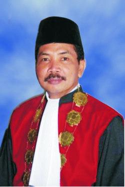 Dr. Binsar M. Gultom, SH, SE, MH